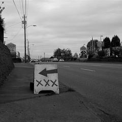 Portland (austin granger) Tags: street urban film sign sex stripclub square portland grey loneliness sidewalk wires pornography arrow xxx telephonepoles gf670 austingranger