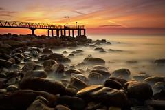 Soul of sunshine (Anto Camacho) Tags: seascape valencia sunshine pier bravo rocks mediterranean mediterraneo amanecer mediterraneansea largaexposicion marmediterraneo longexpoure xilxes chilches valenciancommunity