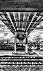 Sous le pont (ANBerlin) Tags: old bridge sky urban bw white black berlin apple nature architecture clouds germany deutschland blackwhite outdoor alt steel natur unter under pillar platform tracks rusty himmel wolken railway bahnhof pedestrian viaduct pylon hires infrastructure rails architektur pont depot sw sbahn brcke schwarz gleise hdr dilapidated rostig bahnsteig infrastruktur stahl iphone sous schienen pfeiler weis sbahnhof viadukt stdtisch schneweide baufllig drausen betriebswerk oberspree iphotography anb030 iphonography fusgnger iphone6s 6splus