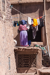Wednesday Wash Day (hardaker) Tags: door woman window ma grate person streetphotography skirt line clothes patio doorway housework morocco laundry marrakech chores portraittuesday tofb urbantotal14