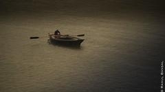 Fighting against all odds (erbansalrahul) Tags: rain boat varanasi thunderstorm boatman ghats banaras