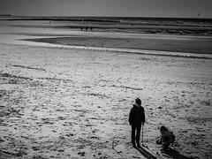 Wimereux9 (Gaatsbi) Tags: ocean light sea bw mer seascape game france beach water monochrome canon landscape kid sand eau child noiretblanc sable nb enfants rays nuages paysage enfant croquet plage nord nostalgie merdunord noirblanc raysoflight wimereux jeux cotedopale rayonsdesoleil