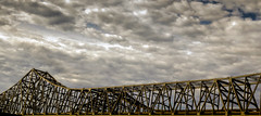 Connection To The Clouds (Wilkof Photography) Tags: county old longexposure bridge shadow vacation sky color geometric nature water metal skyline clouds contrast rural canon river mississippi lens landscape outside golden la countryside louisiana colorful industrial december driving skies afternoon natural cloudy hiking geometry horizon neworleans hill perspective scenic vivid windy overcast panoramic symmetry gretna le nd mississippiriver americana serene ccc riverfront roadside hazy hillside habitat backroads picturesque oxidize cloudcover daytrip humid vantage cantilever gno ndfilter neutraldensity t4i canont4i wilkof