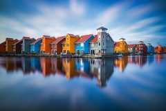 Coloured Wood (albert dros) Tags: longexposure houses water netherlands dutch reflections cityscape colours harbour thenetherlands daytime woodenhouses reitdiephaven albertdros
