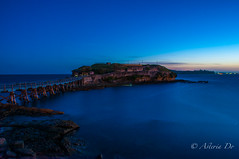 Bare Island (Asteria D.) Tags: ocean park blue sunset sky seascape nature yellow night island photography bay landscapes rocks long exposure purple dusk bare national colourful botany
