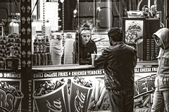 Interaction..... (Kevin Povenz) Tags: street carnival blackandwhite bw black monochrome evening michigan streetphotography fair april customer wyoming interaction vender 2016 westmichigan kentcounty canon7dmarkii kevinpovenz