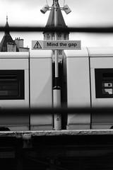 Mind The Gap (Alexander.Banks) Tags: blackandwhite london monochrome station train nikon railway publictransport charingcross d5200