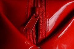Red Bag (mitchell_dawn) Tags: red macro monochrome bag vinyl case zipper boombox cosmetics zip pvc washbag makeupbag emilythestrange macromondays