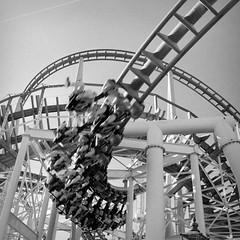 Moving (p2-r2) Tags: park sky blackandwhite lund film amusement movement nikon ride sweden stockholm tracks 400 rails rollercoaster f3 grna kentmere nikkor28mmf28ais