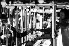 Leave (GioiAndrea) Tags: street light shadow people blackandwhite white black leave canon photography store eyes strada hand zoom gray persone ferrara tamron mercato commercio glances sguardi scambio