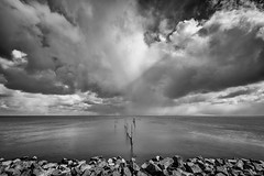 The rain is coming... (koos.dewit) Tags: sea sky seascape holland water clouds landscape rocks fuji thenetherlands fujifilm friesland ijsselmeer afsluitdijk koosdewit fujixe2 fujinon1024mm koosdewitnl