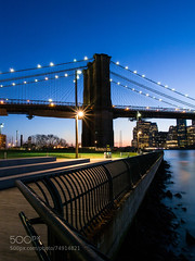 Brooklyn Angles (Justin S Reid) Tags: park new york city nyc longexposure bridge blue sunset sky urban newyork reflection building water skyline architecture brooklyn night river lights long exposure cityscape unitedstates manhattan olympus east brooklynbridge eastriver omd brooklynbridgepark em5 500px ifttt olympusomdem5 dierjscreensaver