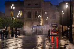 Seville Jan 2016 (12) 039 - Wet and dark in the city (Mark Schofield @ JB Schofield) Tags: santa plaza bridge parque people streets wet public caf rio architecture bar night umbrella reflections river dark ceramic puente graffiti la los spain guadalquivir san expo cathedral maria candid transport iglesia tram seville espana cruz tiles parasol universidad alcazar pavilion oranges harp andalusia cobbles encarnacion luisa giralda isla embankment metropol arenal justa triana macarena remedios cartuja alamillo bernado chapina