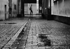 Side street (Nikonsnapper) Tags: street man wet lines rain cool cardiff olympus uncool unposed cobbles zuiko omd drainage em1 leadin 1240mm uncool2 uncool3 uncool4 uncool5