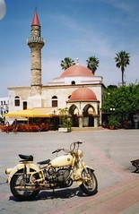 Kos, Greek Island, Minaret and old BMW motorcycle (rossendale2016) Tags: old trees roof red two colour church leather yellow vintage religious army island greek stand site spring cafe sand ancient call sitting suspension drum balcony minaret side prayer rusty gear kos cage mosque tourist palm luggage crescent rack solo seats cycle dome bmw motorcycle brakes brake motor unusual petrol expensive popular rare pedal handlebars tyres exhaust aluminium pinnacle collectable lever carburettor brakelever sidestand mudguards footrests