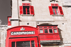 Red British telephone box and red shutter windows, Valletta, Malta (Jacek Wojnarowski Photography) Tags: windows red building vertical architecture facade europe outdoor bottom malta right front telephonebooth valletta blackandwhitephotography lowangle selectivecolor selectivecolour redtelephonebox 6x4 buildingexterior blackandwhitebackground bulitstructure