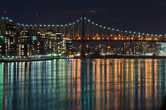Shiny Night Reflections (Lojones13) Tags: longexposure newyork reflection water cityscape nightscape eastriver gleaming edkochqueensboroughbridge