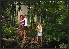 Fishing (rachFNQ) Tags: travel smile river children happy fishing vietnamese village wave bamboo vietnam mekongdelta waving travelphotography