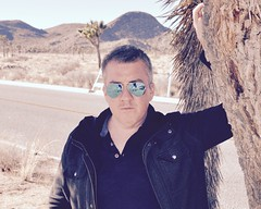 Cool James - Portrait (Blue Rave) Tags: joshuatree joshuatreenationalpark california park bloke dude guy male mate people nature sunglasses rayban portrait 2016 jtnp hike hiking jacket aviator reflection gay road face closeup