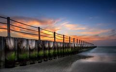 Jumeirah public beach (Bean Do) Tags: ocean travel bridge blue sunset red sky cloud beach water misty architecture landscape pier seaside dubai cloudy outdoor dusk uae shoreline chain emirates shore beando