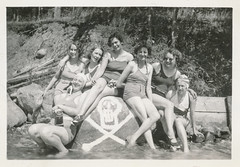 Women in swimming suits sit on a rock with a skull and crossbones (simpleinsomnia) Tags: old woman white black monochrome swimming swim warning vintage found skull blackwhite antique snapshot suit photograph vernacular swimsuit crossbones foundphotograph skullandcrossbones swimmingsuit