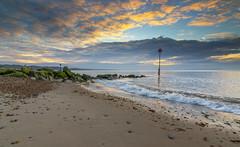 Avon Beach March 21 (nicklucas2) Tags: sea cloud seascape beach rock sunrise dawn seaside sand wave pebble isleofwight solent needles mudeford avonbeach