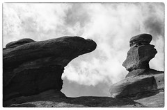 Spires - Red Rocks, Colorado (gastwa) Tags: shadow red sky blackandwhite bw sun white mountain abstract black film nature monochrome clouds analog landscape nikon scenery rocks kodak tmax f14 g andrew 400 58mm afs f6 gastwirth andrewgastwirth