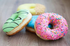 Donuts (Yardstick Marketing) Tags: pink food brown white color cake circle dessert baking yummy break candy hole sweet chocolate vibrant dough background fat group ukraine gourmet caramel sprinkles snack donut doughnut pastry icing colored bun multi unhealthy baked glazed refreshment