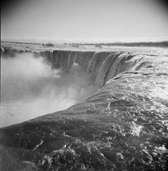 at the edge (.grux.) Tags: mist 120 6x6 film mediumformat niagarafalls close plasticfantastic waterfalls edge ilfordxp2 holga120n testroll