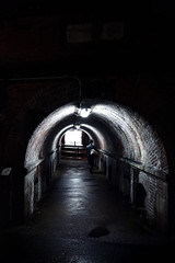 The Light at the Beginning of the Tunnel (Novowyr) Tags: street city light japan night dark leaving person licht alone crossing darkness entrance tunnel beginning human single exit enter underworld isolated dunkel kyōto 京都市 endofthetunnel endedestunnels distantperson