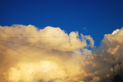 (nic lawrance) Tags: blue light shadow sky cloud colour nature lines yellow clouds outdoor warmth cotswolds pale wires cumulus form shape