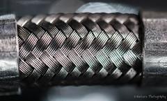 Braided steel cable - Harley Davidson (KWinters Photography) Tags: macro texture metal closeup silver nikon stainlesssteel pattern steel cable harleydavidson motorcycle nikkor nikondigital stainless braided d5500 braidedcable nikondsl