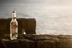 desperado (pamo67) Tags: light lake muro glass wall lago bottle afternoon tequila liquor shore booze warmlight vetro parapet liquore bottiglia pomeriggio trasparenza trasparency sponda parapetto pamo67 pasqualemozzillo