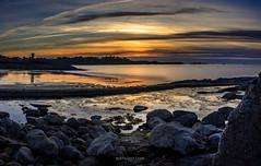 Plage du Port Blanc (bertrandlamy) Tags: ocean longexposure sea sun mer seascape france night clouds canon landscape soleil brittany bretagne exposition paysage nuit bord couch longue 40d