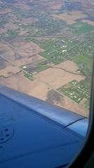 no waves of grain yet (army.arch) Tags: window plane airplane wing fields farms lookingdown