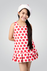Little asian girl (Patrick Foto ;)) Tags: portrait people cute girl beautiful beauty smile face childhood fashion female hair studio asian thailand happy person grey one stand kid funny asia pretty child looking dress emotion little sweet background joy daughter young adorable style happiness thai attractive concept lovely cheerful bangs isolated confident