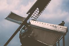 Mill blades (m0nt2) Tags: light holland detail reflection closeup clouds 50mm zon zaanseschans sailcloth primelens d300s millblades m0nt2