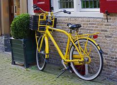 Yellow bike (Mary Berkhout) Tags: bicycle yellow geel centrum voorburg fiets herenstraat bewegen maryberkhout