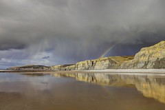 The calm before (pauldunn52) Tags: seascape storm reflection heritage beach wet rain wales temple bay coast rainbow sand cliffs glamorgan