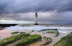 Mid Winter (Tony Shertila) Tags: england sky lighthouse water weather clouds geotagged coast sand rocks europe day waves cloudy britain outdoor tide horizon shore wallasey wirral newbrighton merseyside irishsea geo:lon=304149628 geo:lat=5344195678