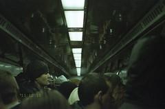 commuting to the office (yellow0testarossa) Tags: face hat train underground 50mm fuji minolta kodak head f14 watching row scan line peoples negative commuting halfface portra800 minoltadynax7 cn16 wearinghat epsonv750 sonysal50f14 sony50mm rowoflight intheunderground commutingtotheoffice nq1rs