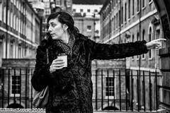 This Way (stonem64) Tags: street people blackandwhite bw london coffee girl fashion scarf bag fuji candid streetphotography style furcoat pointing stockcategories fujifilmxt1 fujifilmxf35mmf2