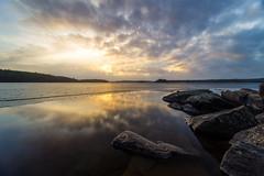 Silence (Arvid Bjrkqvist) Tags: sunset sun lake seascape ice water colors beautiful reflections landscape rocks sweden transparent polarizer tranquil vanderydsvattnet
