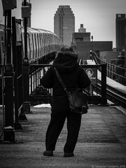Astoria, Queens (Sebastian Sinisterra Photography) Tags: camera new york city nyc winter white black cold tower station train canon buildings point outside outdoors person lights back shoot boulevard afternoon bright edited portait platform tracks n queens astoria borough lic behind q 510 recent bnw blvd hs lightroom sx citi qns
