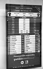 Betting Odds T-Max 400 Pyrocat HD (Man with Red Eyes) Tags: slr monochrome shop analog 35mm blackwhite nikon kodak f100 numbers lancaster tmax400 50mmf18d betting semistand presoak 11100 silverhalide pyrocathd 16mins