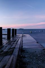 Pink sunrise (k.tusnio) Tags: morning pink sea sky nature water clouds sunrise landscape pier still nikon long exposure sweden surface kit hdr malmo bjarred d5100
