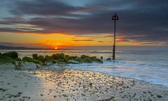Avon Beach Sunrise April 8 (nicklucas2) Tags: sun seascape rock sunrise seaside sand seagull groyne avonbeach