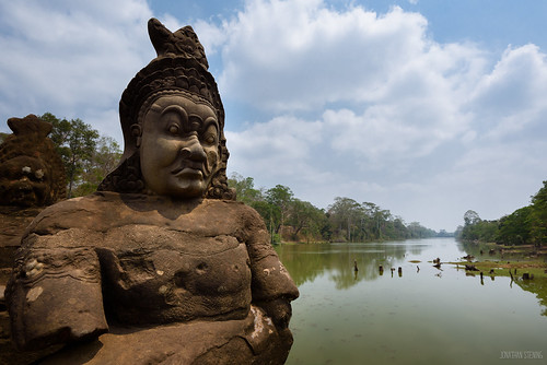 Demon statue on the South Gate bridge into Angkor Thom, Cambodia