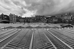 Edinburgh Old Town across Waverley Station (Philip Gillespie) Tags: street old uk bridge roof sky bw white storm black building window glass rain station weather clouds dark landscape photography grey scotland town ancient edinburgh cityscape britain top railway trains center april panels mound stacked scots lothian terraced 2016 sequent