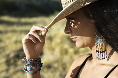 Portrait of woman. (sunil.cheloor) Tags: shadow portrait color face horizontal closeup outdoors hawaii unitedstates profile posed sunny maui photograph shade sideview cowboyhat protection strawhat tipping southwestern caucasian headandshoulders onepersononly midadultwoman 3035years